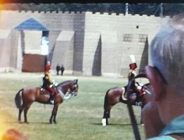 A still from a vintage home movie showing a military display at Aldershot