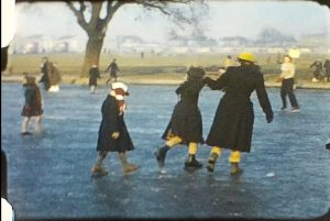 A picture of people Ice Skating from a vintage home movie from 1956