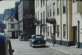 A still image from an 8mm vintage home movie of a seaside town in 1959