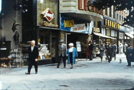 A still image showing a row of shops from a vintage home movie taken in Germany and Holland in 1961