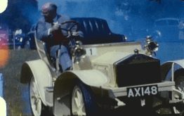 A clip from a vintage home movie featuring a vintage car display from 1962