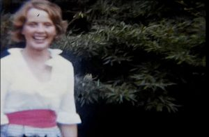 A still image from a vintage home movie taken at a school fete or garden party in the 1970s