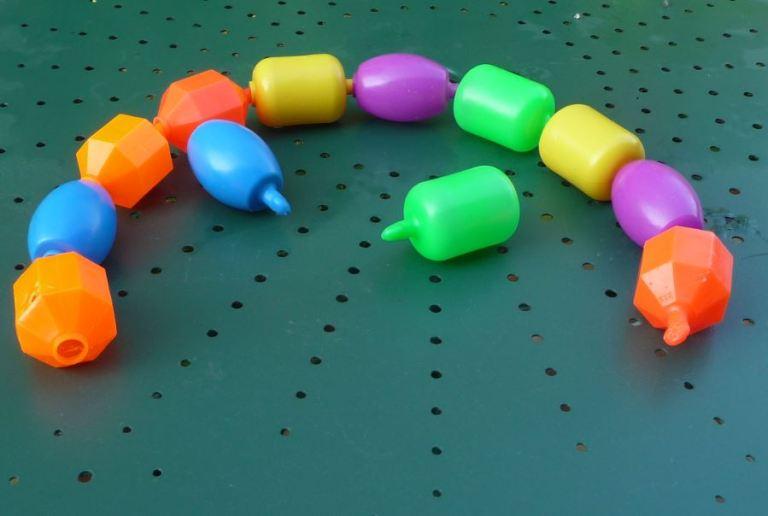 perles en plastique Fisher Price de Kikitch