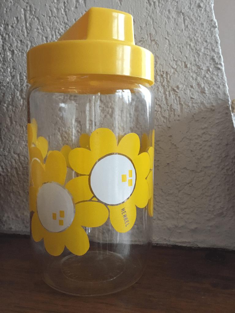 Pot Henkel à fleur jaune