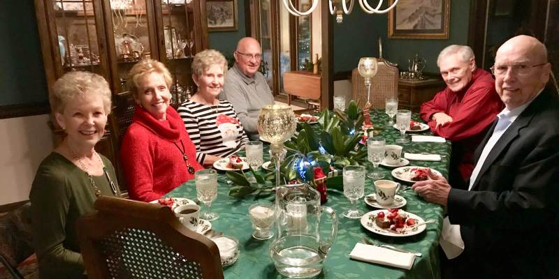Photograph of a dinner table with guests.