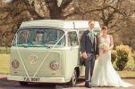 bride and groom by campervan