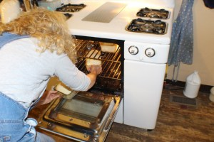 The vintage farm wife baking bread.