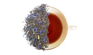 Vintage Fork Blend loose leaf tea displayed over half of a brewed cup of tea