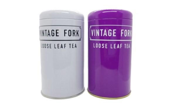 white and purple tea storage tins