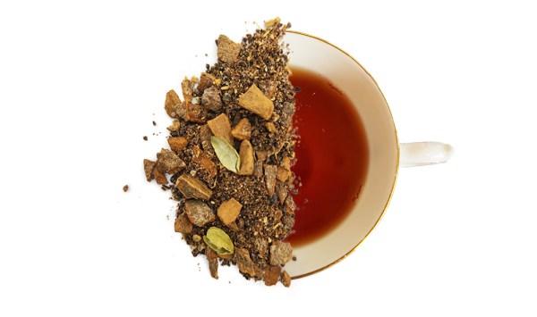 tiger spice herbal tea leaves split over a cup of brewed tea