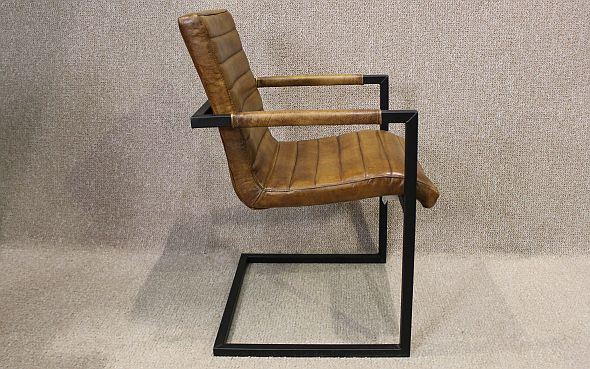 Tan leather armchair with steel frame A wonderful leather