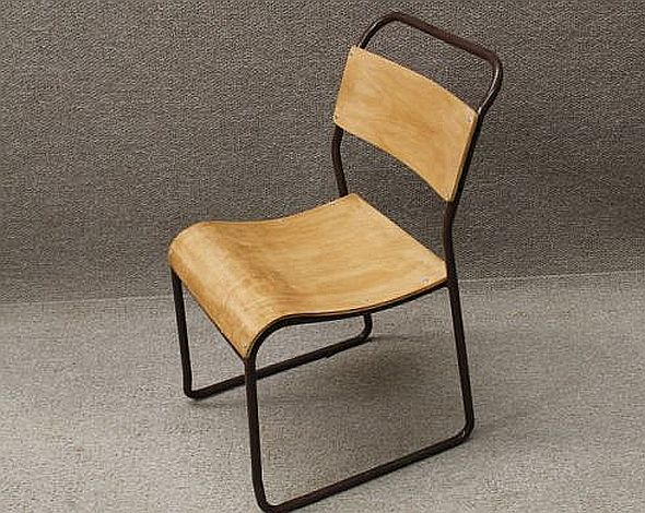 Old stacking chairs with a tubular steel frame and plywood
