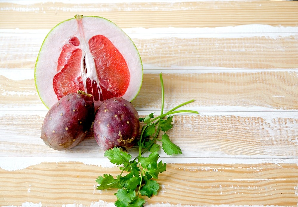 Refreshing, fruity and unique, this Prickly Pear Hard Cider Cocktail with Cilantro and Pomelo tastes as yummy and bright as it looks.   vintagekitty.com
