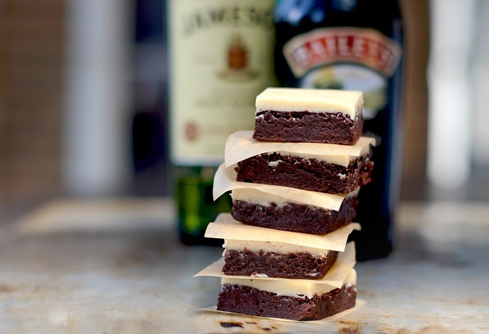 Boozy Irish Brownies have a fudgy chocolate layer that is topped with a whiskey and Irish cream white chocolate ganache. YUM! | vintagekitty.com