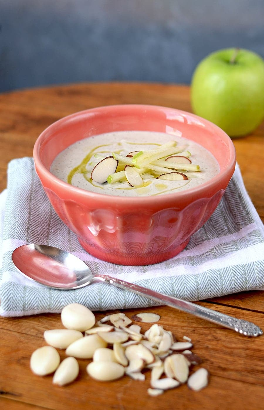 Ajo Blanco is a savory cold soup made with almonds and garlic from Spain. This version uses crisp green apples for a fresh tart flavor.