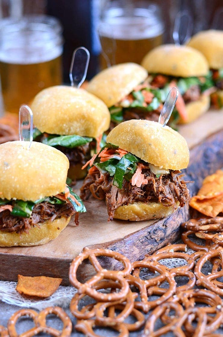 Slow Cooker Pork Barbecue Sliders are smoky and sweet with a barbecue sauce made from the pork drippings and topped with a fresh bok choy carrot slaw. | vintagekitty.com