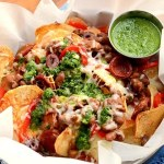 Homemade potato chips get loaded with savory Spanish ingredients in this fusion recipe. Far from ordinary, these nachos are topped with Manchego cheese, Chorizo sausage and served with a fresh, zesty Chimichurri.   vintagekitty.com