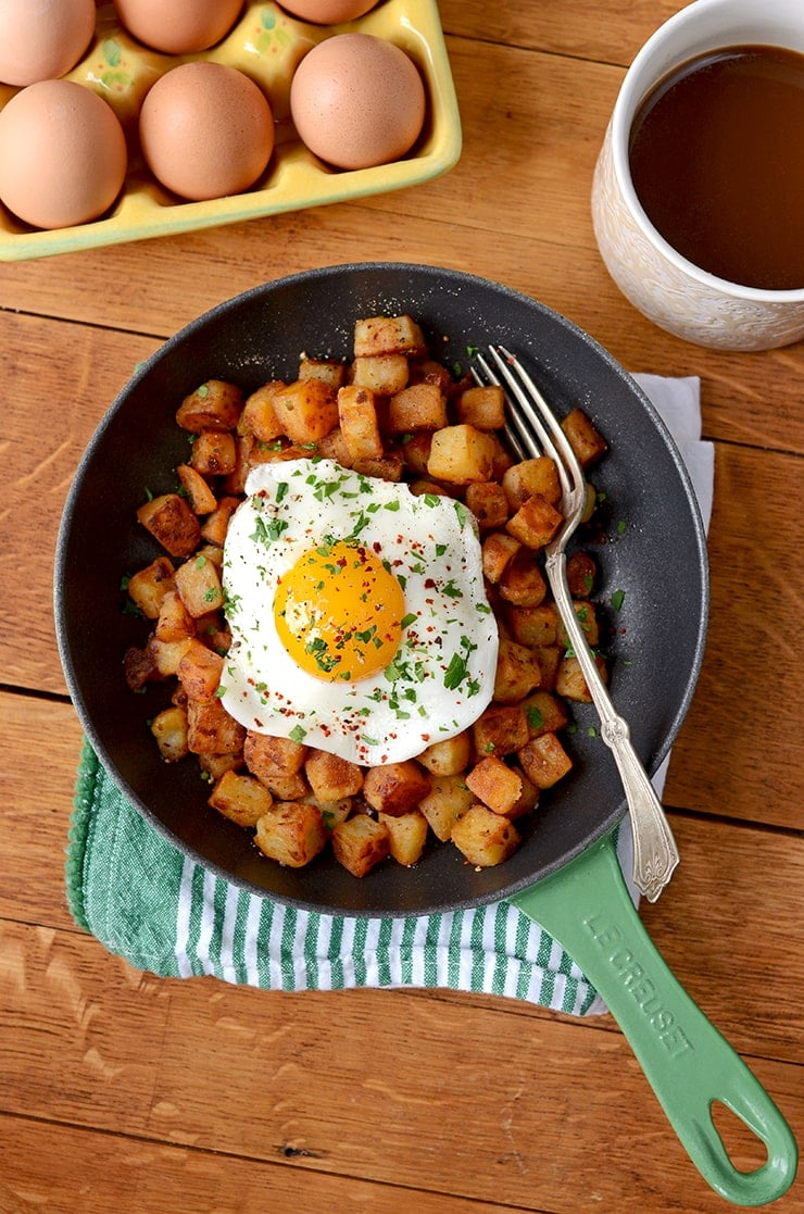 Picture of Aleppo Pepper Breakfast Potatoes with Fried Sunny Side Up Egg and Coffee