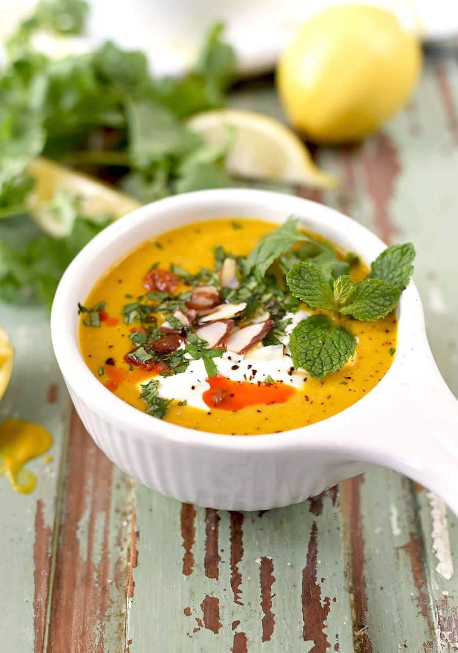 All the flavor in about half the time! Our Moroccan Pot Sweet Potato Soup is made in the Instant Pot for an easy weeknight meal. We've topped it with a minty herb mix and harissa for bold, low calorie flavor. #instantpot #soup #healthy #sweetpotato #vegan #vegetarian
