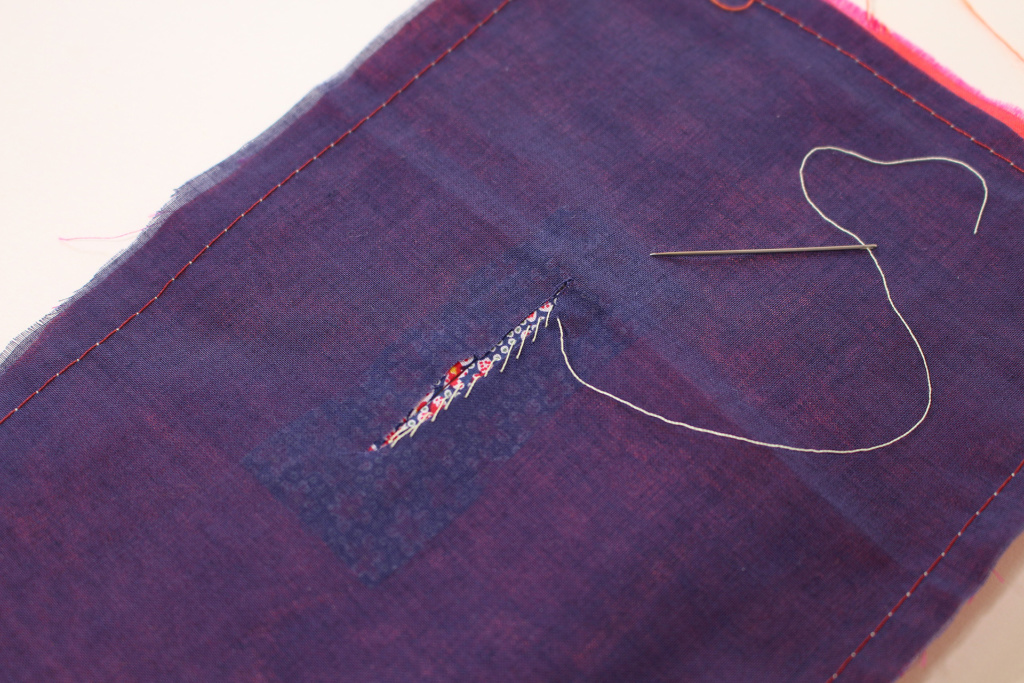 Back of bound buttonhole, specifically sewing the stitching attaching the lining or facing. | Vintage on Tap
