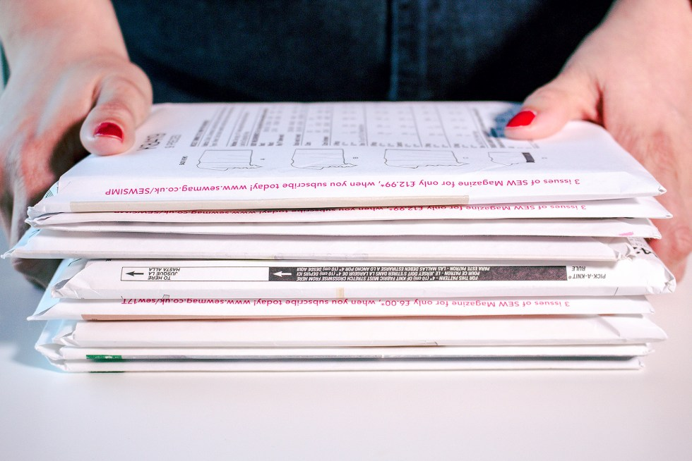 Stack of paper sewing patterns