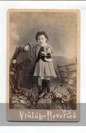 1800s girl holding a doll