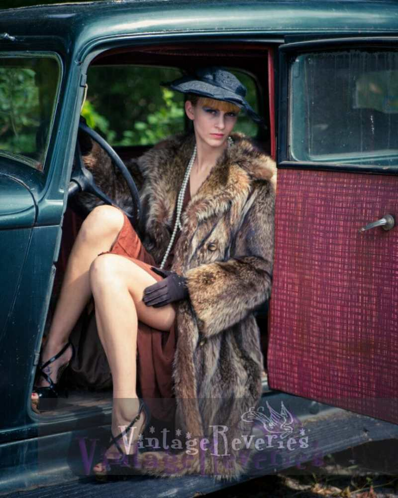 model in an old car