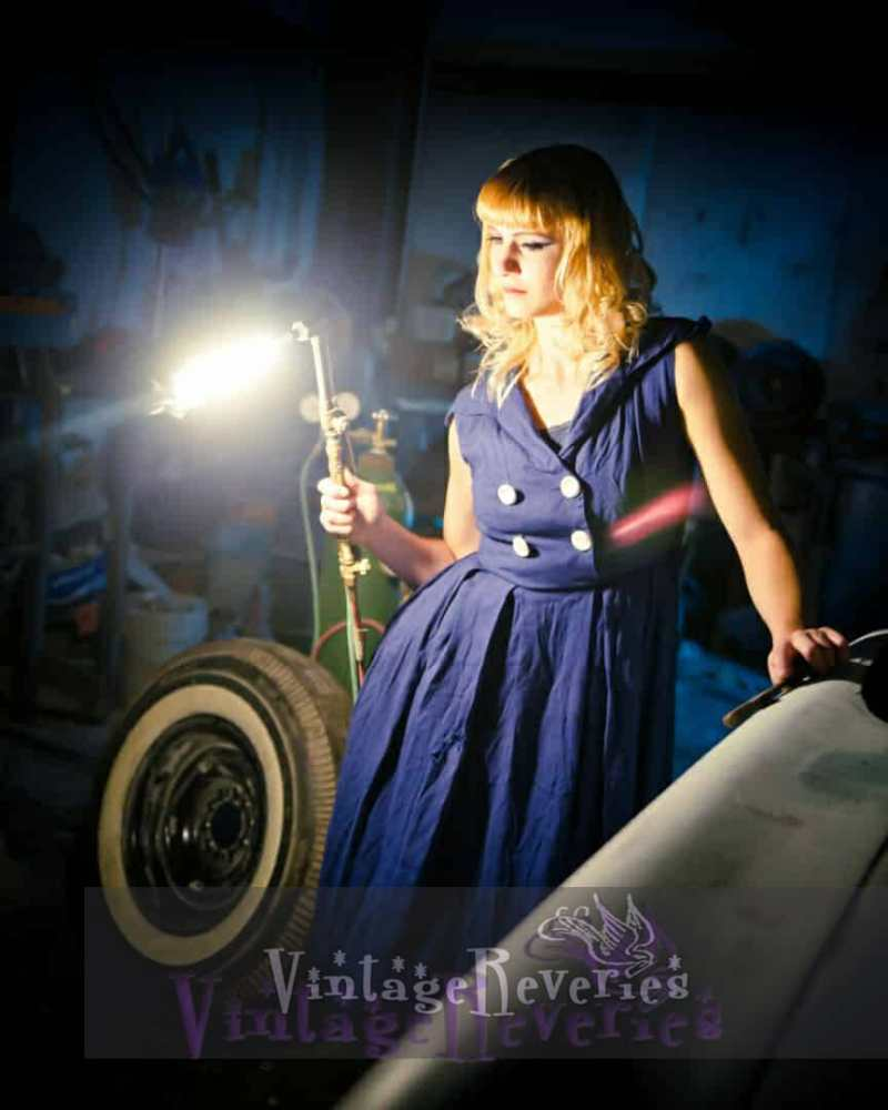 pinup model with a blow torch