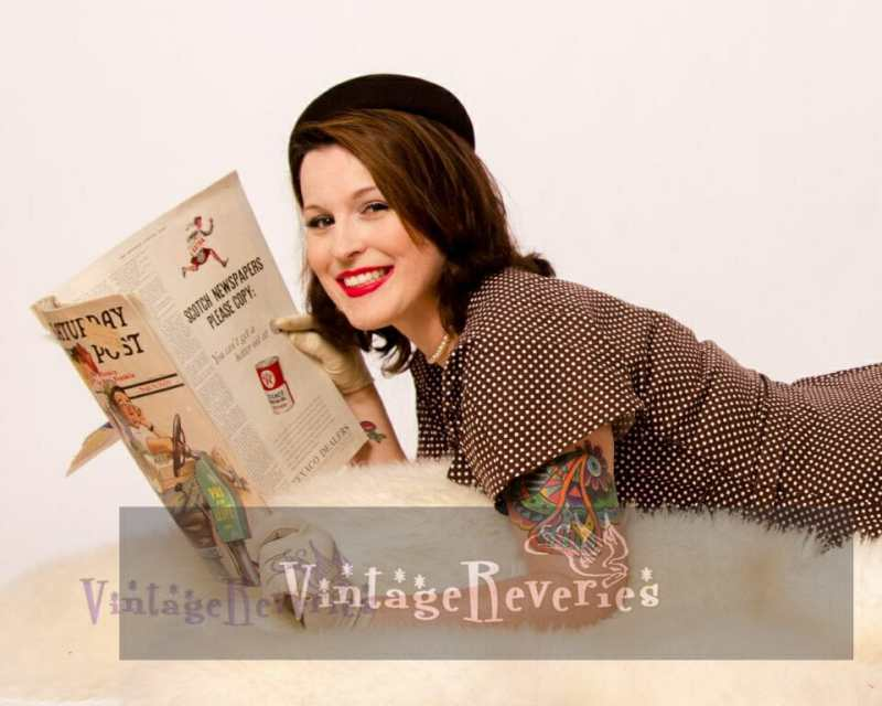 model posed with an old magazine