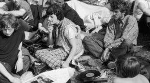 A group of young people listening to records in the 1960s
