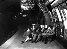 People listening to a gramophone player on a platform at Waterloo Station, London in 1928