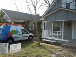 A picture of a Google truck at a customer install. Note, the lawn sign promoting the Google Fiber project.