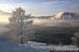LISTVYANKA, RUSSIA: A view of the Baikal lake taken 11 December 2000 from the village of Listvyanka, 70 km from Siberian city of Irkutsk. Buryat ethnic Mongols settled the shores of Siberia's Lake Baikal long before the 13th-century conquests of Genghis Khan, and centuries ahead of the Russian fur traders who arrived in the 1640s. (Photo credit should read ALEXANDER NEMENOV/AFP/Getty Images)