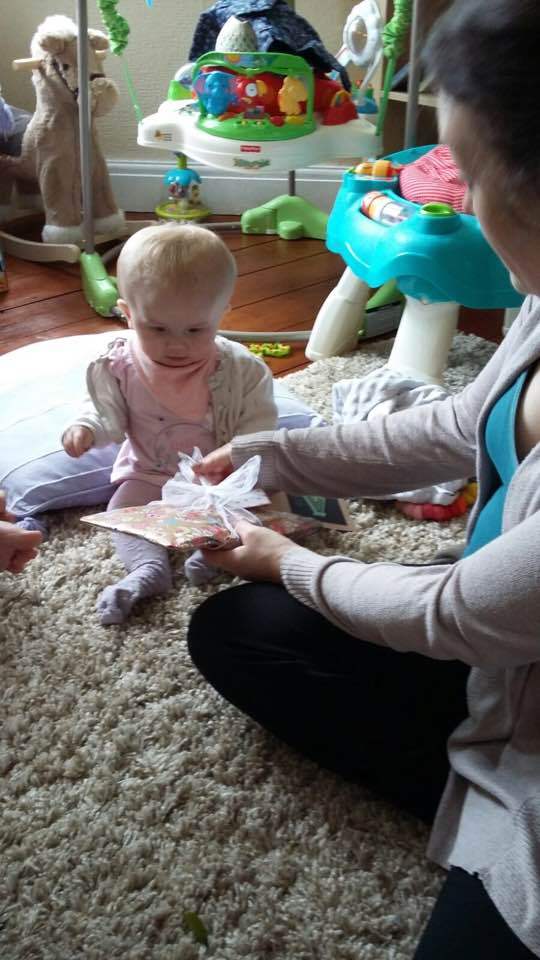 Violet opening birthday presents