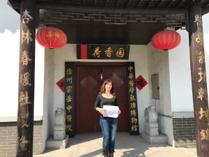 Maria Louisa Vocca in front of the Chinese Medical Qigong Musuem
