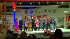 Dr. Chow (the third from the left) performed during the opening ceremony of the Chinese Medical Qigong Museum.