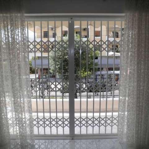 Retractable security gate for a 1st floor balcony door
