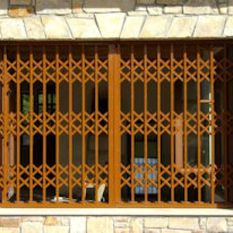 Retractable security grilles in a residential window
