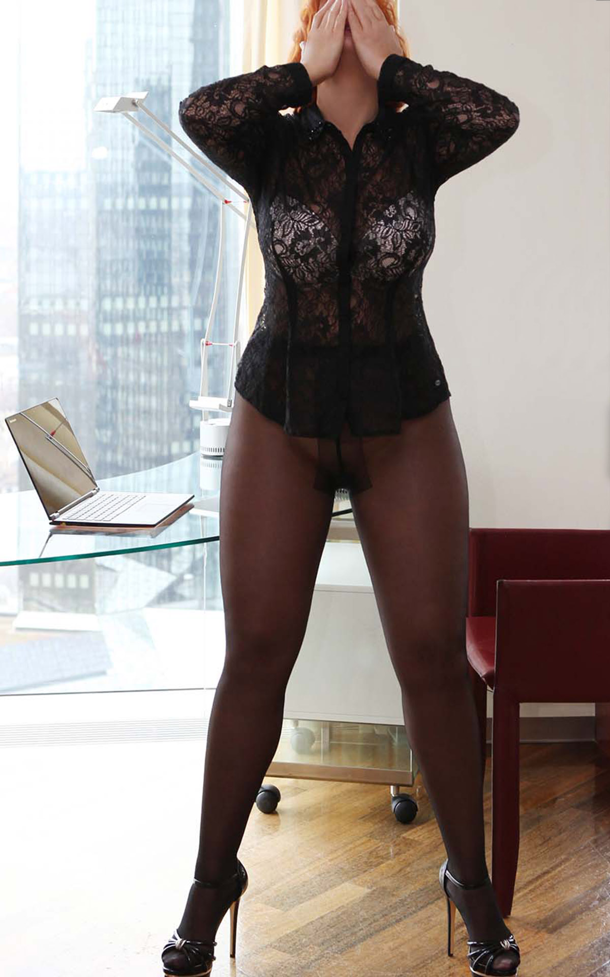 Sofia Elite escort in Nilons and high heels in the office