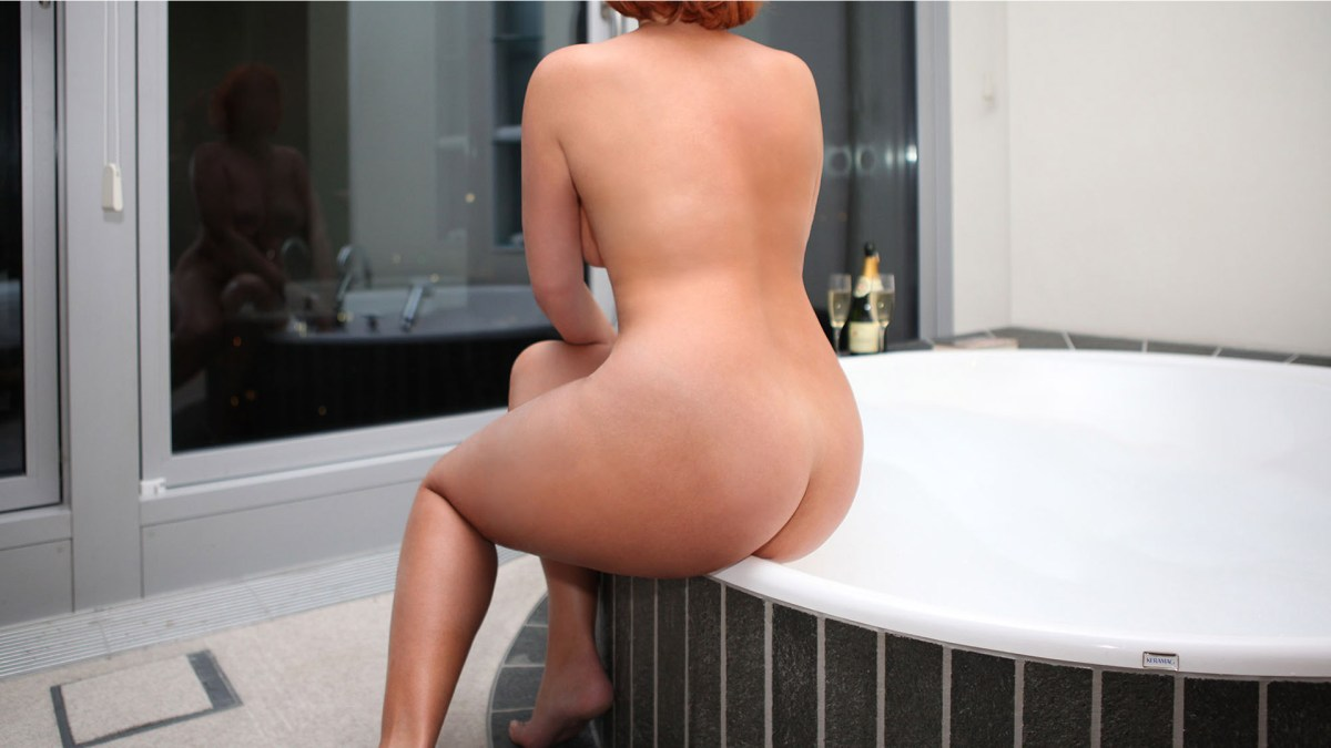 Sofia VIP Companion BBW with a magnificent butt naked in the bathroom sitting on the edge of the bathtub with her back