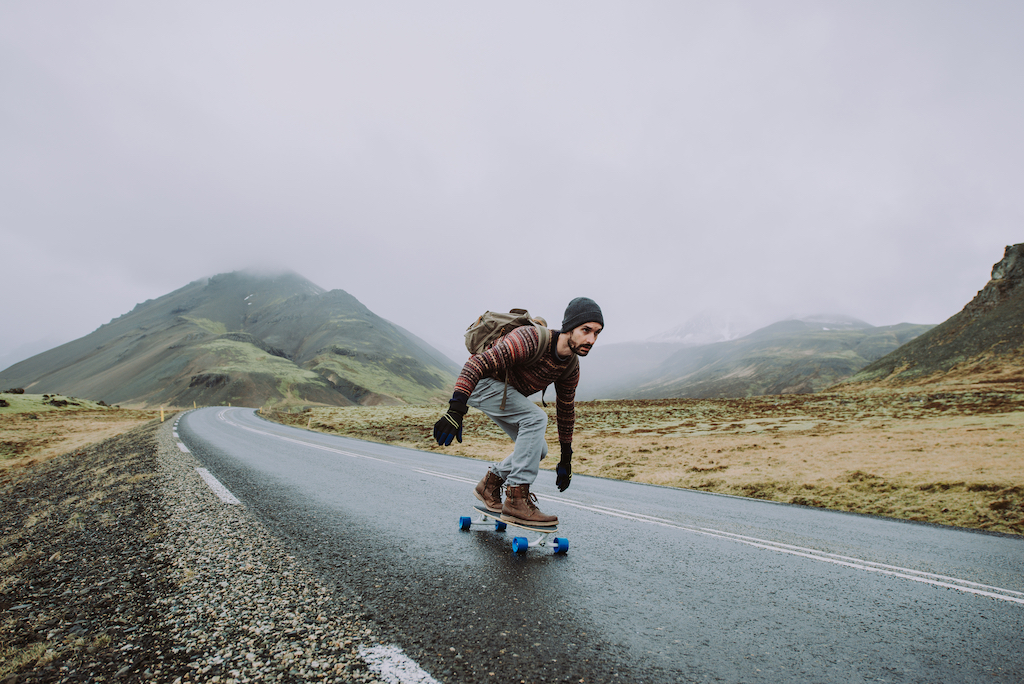 Travel Images - Man Skating in Iceland