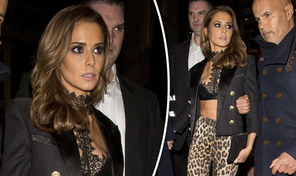 Cheryl Fernandez-Versini looks glum as she flaunts flat tummy at Kimberley Walsh's hen do