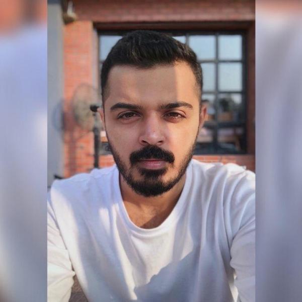 Jai Mehta Filmmaker selfie in white