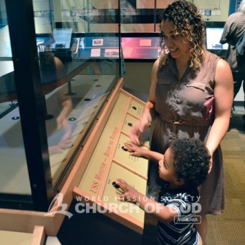 A mommy and her son looking at a ship artifact at The Mariners' Museum.