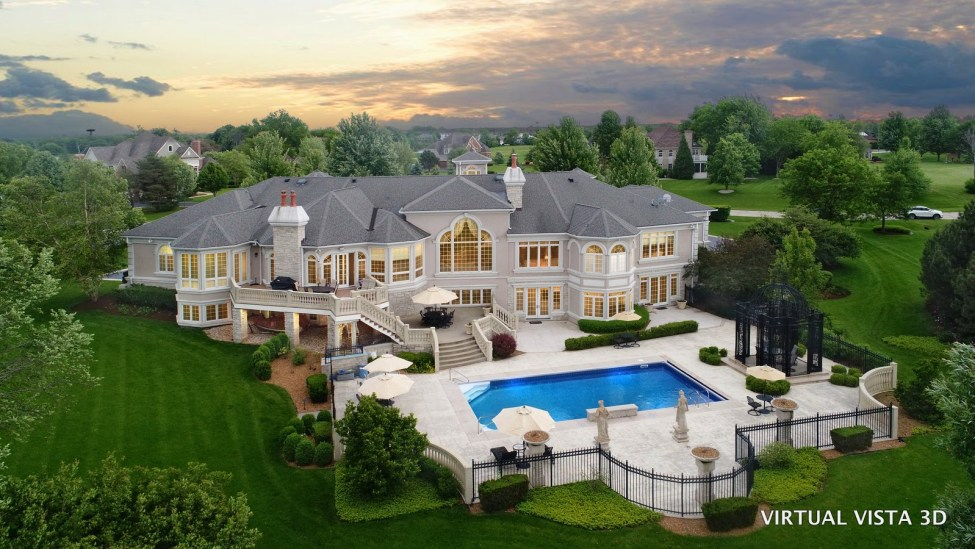 Mansion with pool twilight aerial photo