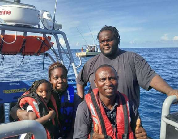 The Fahie family on board Gorda Peak with VISAR Crew Member, Shawn Gilford.