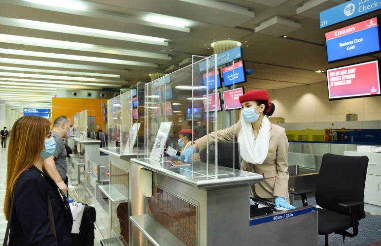 Emirates boarding agents, dressed in personal protective equipment (PPE), will facilitate the boarding sequence.