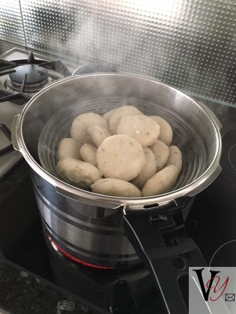 Place in another oiled container that will fit into a steamer comfortably. Leave enough space in between to let the steam circulate freely. Re cook the kneaded dough in the hot steamer for a further 20-25 minutes.