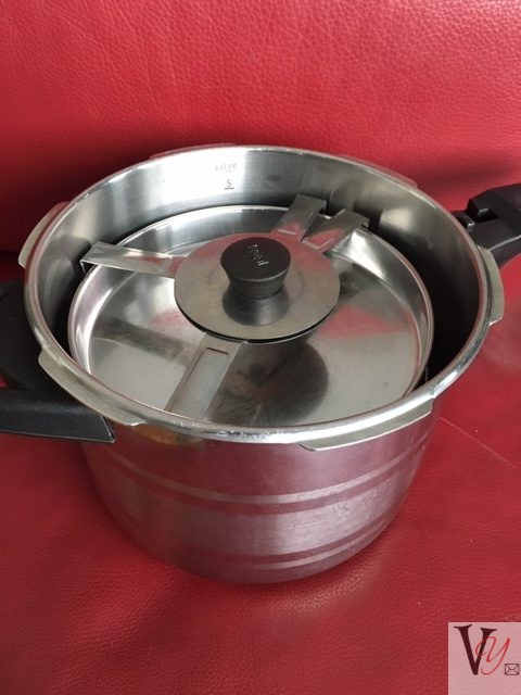 Assemble the dhokra unit and place inside the steamer, ensuring that the water at the bottom is bubbling vigorously. Close and turn the heat to medium and steam for 20 minutes. If using the pressure cooker as the steamer pot, use either an ordinary tight-fitting lid or turn your cooker setting to steamer if available.