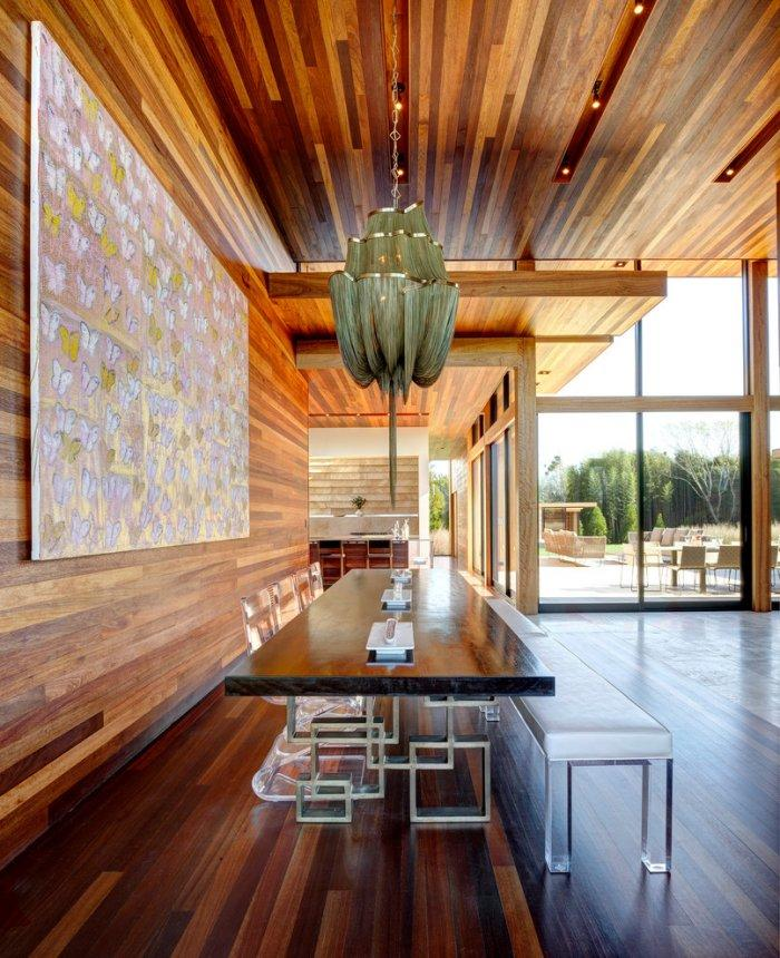 Mahogany Brown walls and ceiling in dining room featuring elegant green chandelier